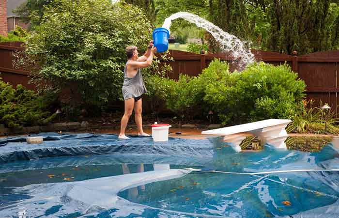 Using a bucket to drain pool cover